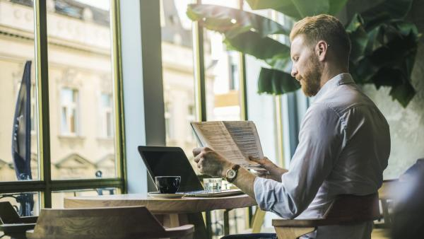 guy looking at his computer