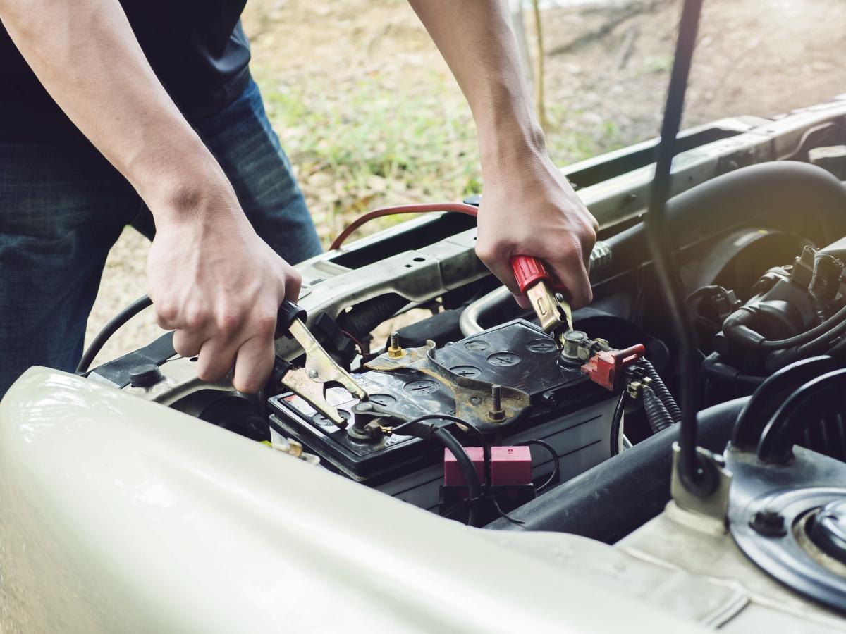 mechanic fixing a car battery